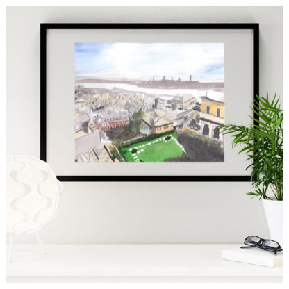 Watercolour painting of Genoa rooftops framed in black over desk
