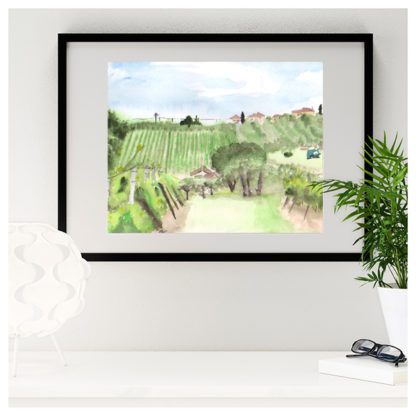 Watercolour painting of Tuscany Vineyard framed in black over desk